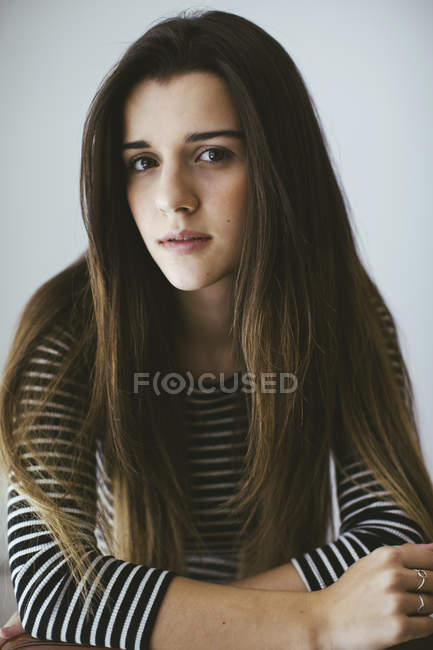 Close Up Of Young Brunette Woman Looking At Camera Brown
