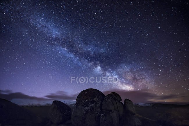 Milky way over ancient granite rocks — Stock Photo