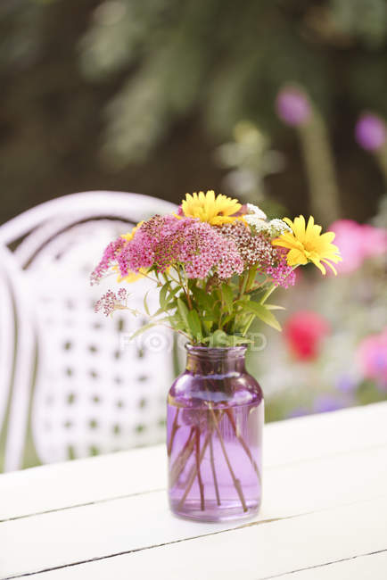 Bunch of flowers on summer garden table — Stock Photo