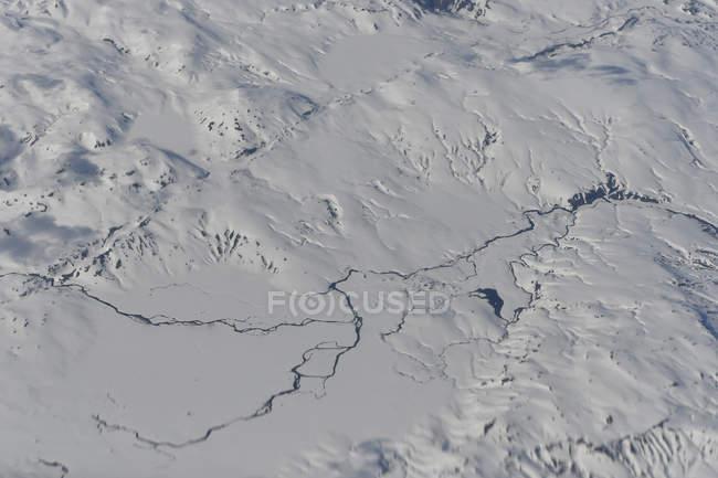 Islândia, vista aérea, Rio e neve, paisagem durante o dia — Fotografia de Stock