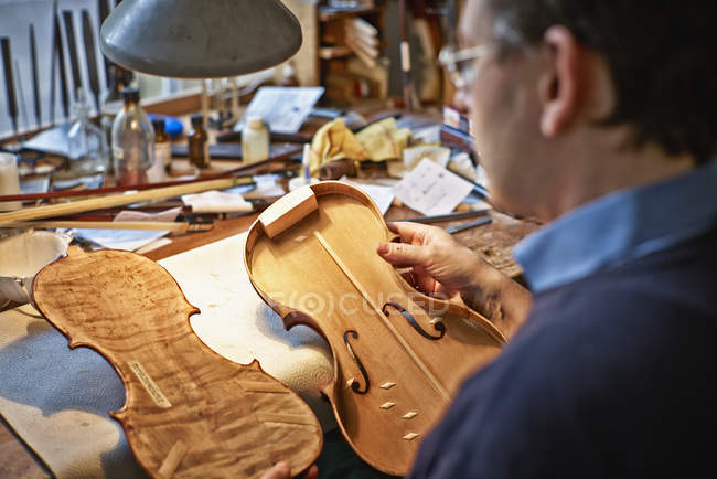Close-up of Violin maker working in workshop — Stock Photo