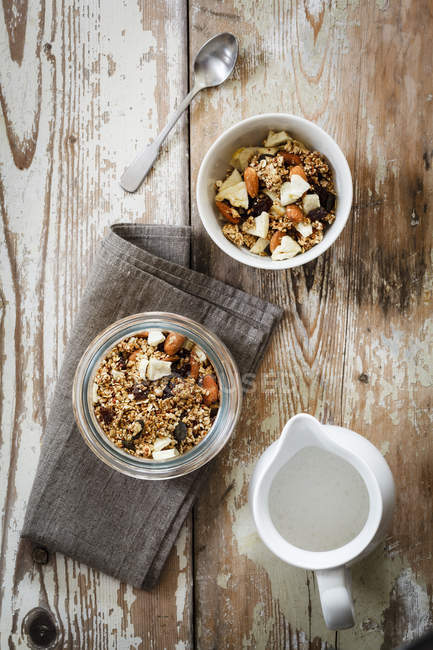 Homemade granola of oat, almond, quinoa, raisin and dried apple rings — Stock Photo