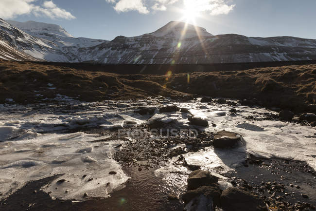 Iceland, Snaefellsnes, water with floes at backlight — Stock Photo