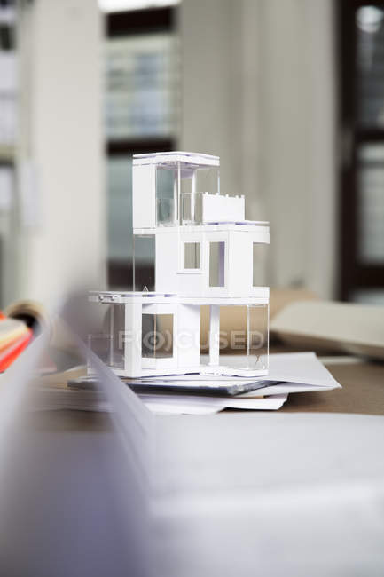 Desktop with architectural model indoors — Stock Photo
