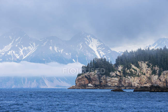 View to snow-covered mountains at daytime, Resurrection Bay, Seward, Alaska, USA — Stock Photo