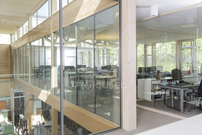 Workplaces in modern office behind glass pane — Stock Photo