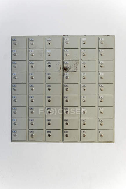 Letterbox on white wall indoors — Stock Photo