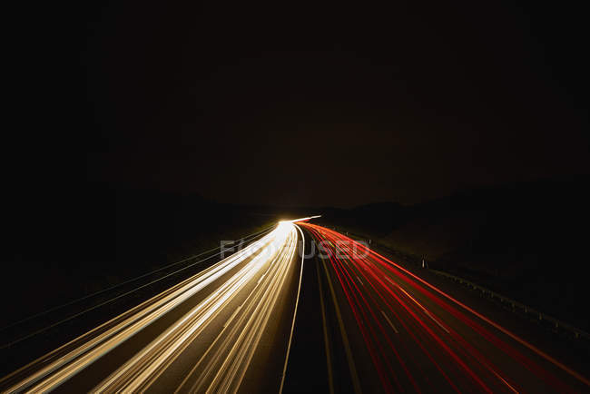 Germany, red and white lighttrails on freeway by night, long exposure — Stock Photo