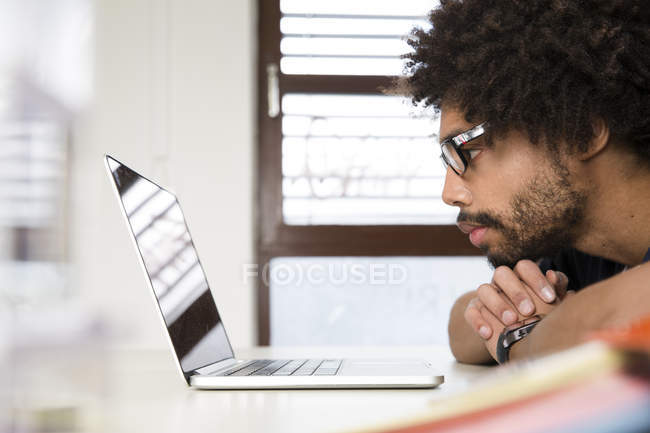 Creative professional using laptop in office — Stock Photo