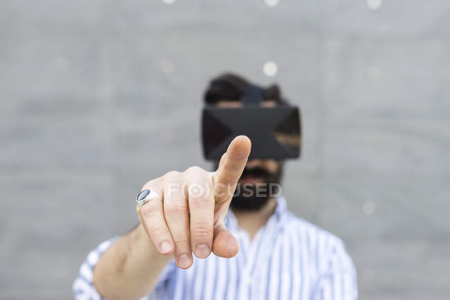 Man playing with Virtual Reality Glasses — Stock Photo