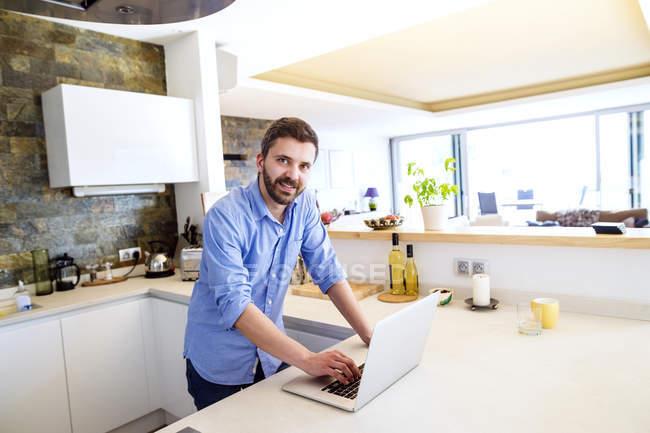 Man Working In Kitchen Using Laptop U2014 Stock Photo