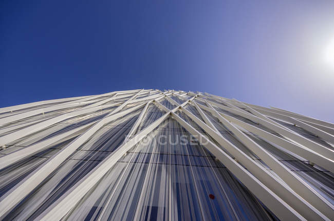 Spain, Barcelona, detail of Telefonica building against blue sky — Stock Photo
