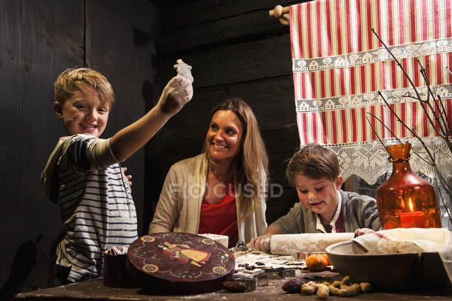 Mother and her two little sons  baking Christmas cookies at Advent Season — Stock Photo