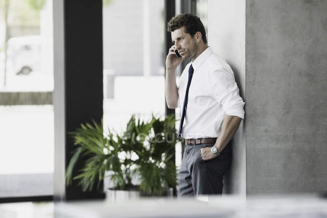 Portrait of Businessman using cell phone — Stock Photo