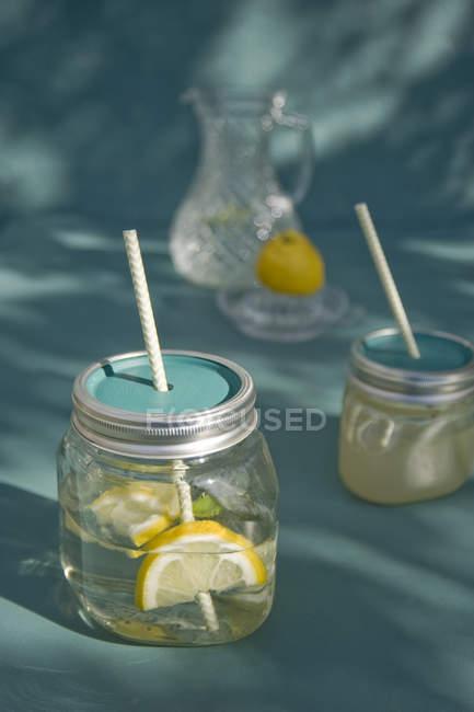Jars of homemade Lemonade with drinking straws — Stock Photo