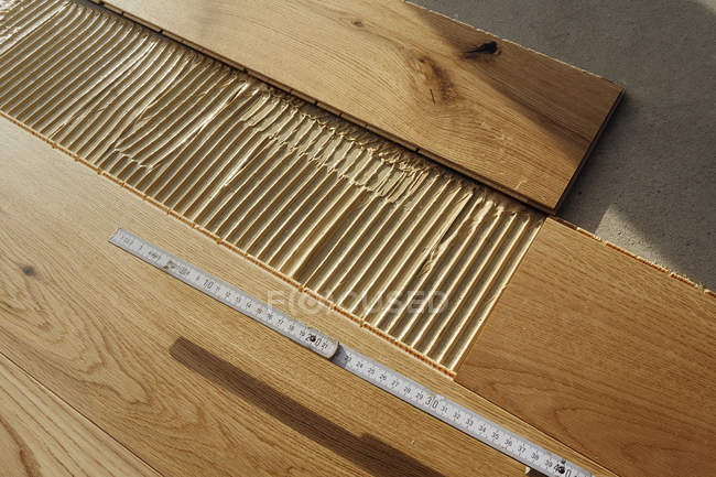 Laying finished parquet flooring, close-up — Stock Photo