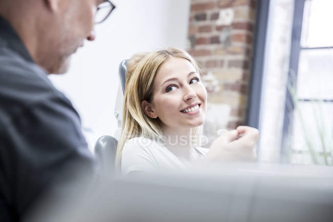 Woman consulting by dentist — Stock Photo