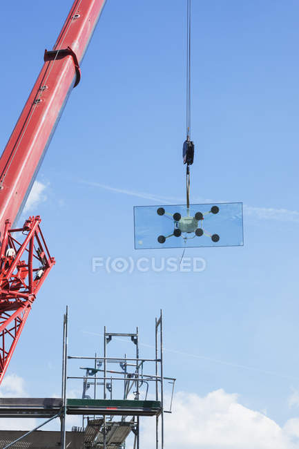 Germany, Cologne, crane with glass pane against sky — Stock Photo