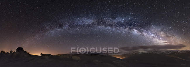 Spain, Milky way over mountains at night — Stock Photo