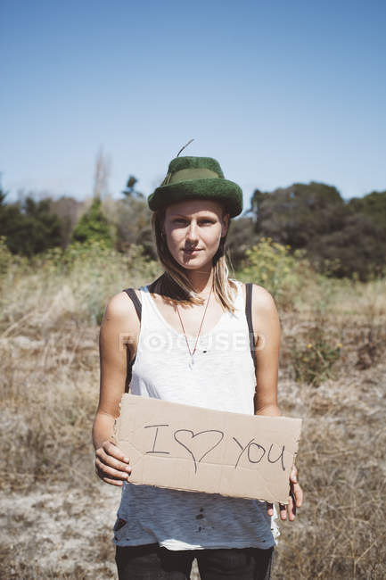 Hippie holding 'I love you' sign in the nature — Stock Photo