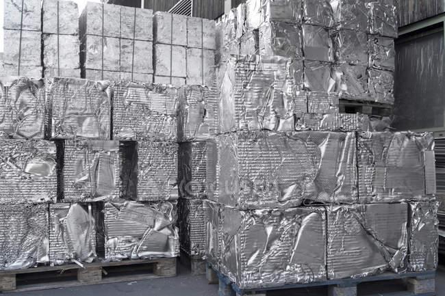 Stacks of aluminium blocks at recycling yard — Stock Photo