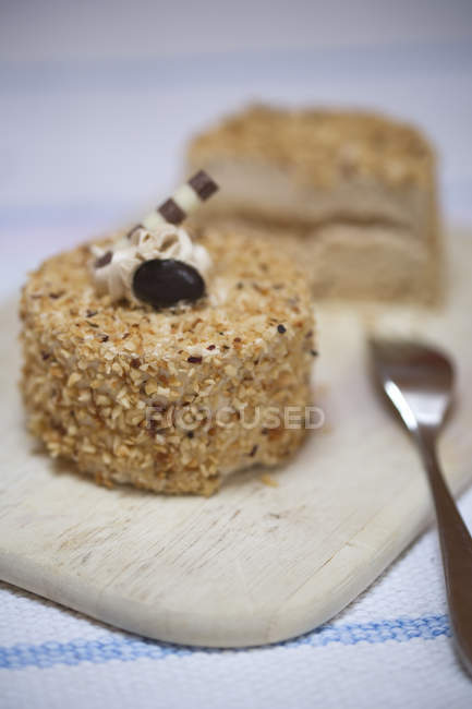 Mocha cream tartlet on wooden board — Stock Photo