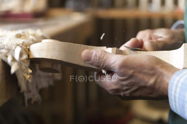Closeup view of violin maker hands at work — Stock Photo