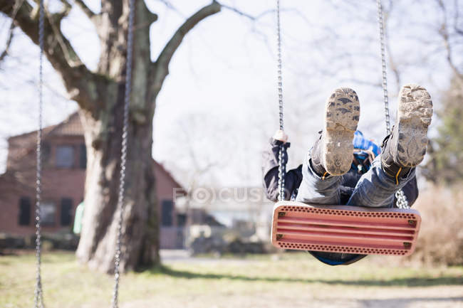 Little boy swinging at playground — Stock Photo