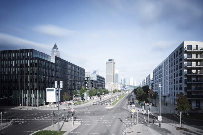 Germany, Hesse, Frankfurt, crossroad at European quarter with view to skyline — Stock Photo