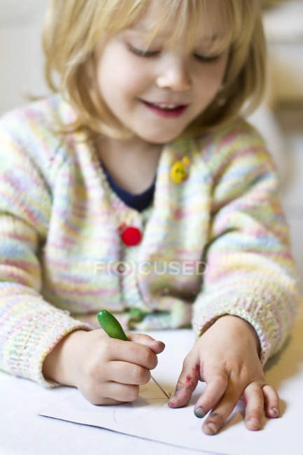 Close-up of Little girl prickling dirty finger — Stock Photo