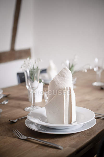 Place setting at Laid wooden table — Stock Photo