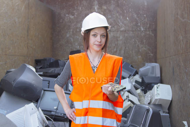 Portrait of female technician standing at recycling yard of aluminium — Stock Photo