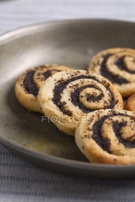 Poppy yeast dough rolls on tin plate — Stock Photo