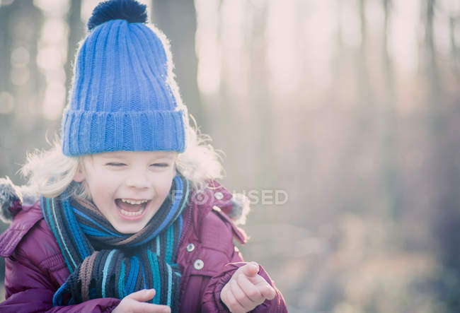 Laughing boy wearing blue woolly hat — Stock Photo