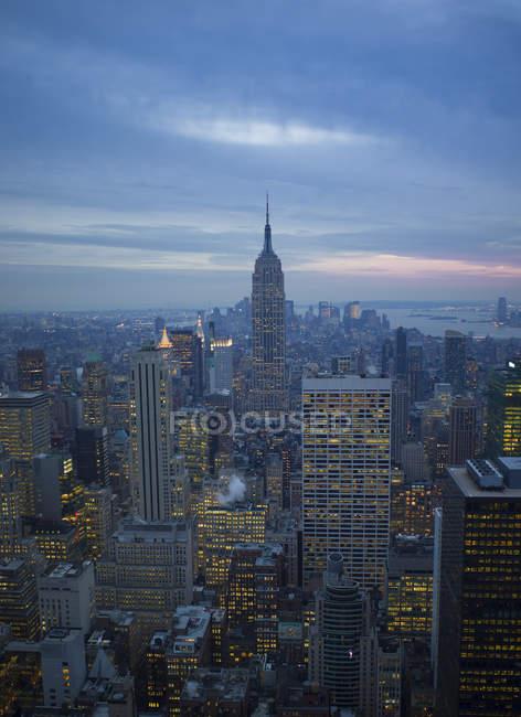 View to lighted skyline at evening twilight, Manhattan, New York, USA — Stock Photo