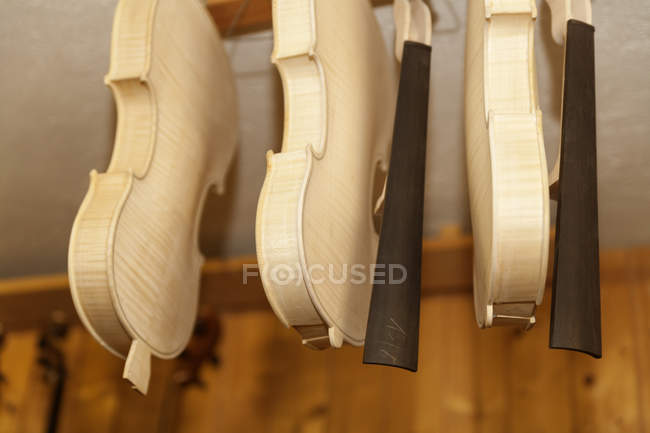 Unfinished violins in a violin maker workshop — Stock Photo