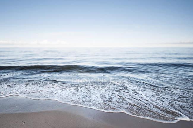Germany, Mecklenburg-Western Pomerania, Usedom, waves on sandy beach — Stock Photo