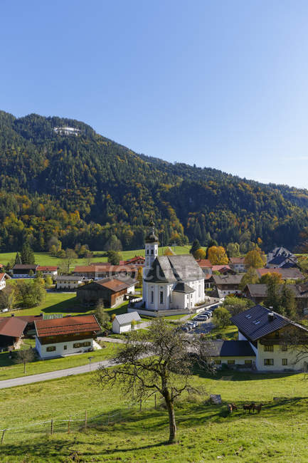 Germany, Chiemgau, View of Sachrang and trees on background — Stock Photo