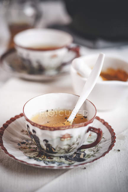 Cup of turmeric tea spiced with pepper — Stock Photo