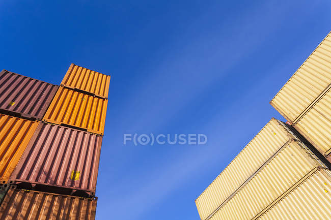Cropped view of cargo containers in harbor — Stock Photo