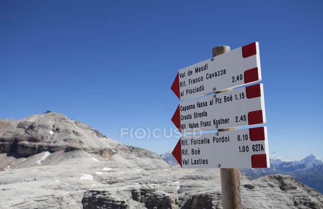 Italy, Trentino, Belluno, Signpost at Pordoi Pass — Stock Photo