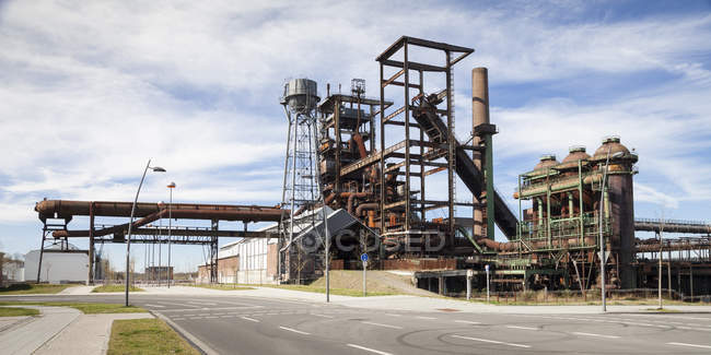 Germany, North Rhine-Westphalia, Dortmund-Hoerde,  Phoenix West, abandoned blast furnace steelmill and water tower — Stock Photo