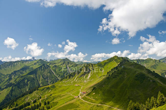 Austria, Vorarlberg, Kleinwalsertal, Allgaeu Alps, Panorama, Luechle Alp and Muttelbergkopf with green hills — Stock Photo