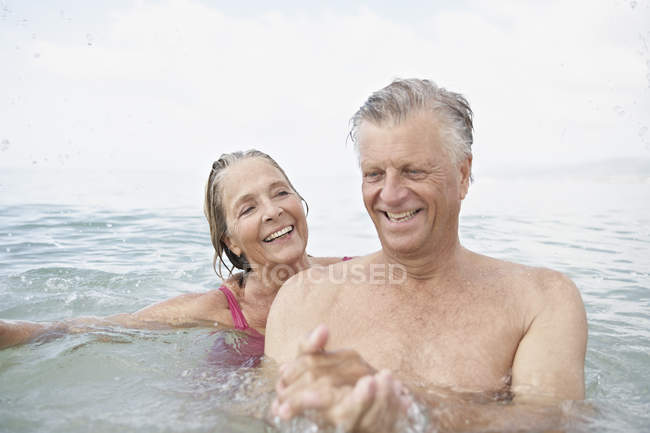 Senior couple swimming in sea — Stock Photo