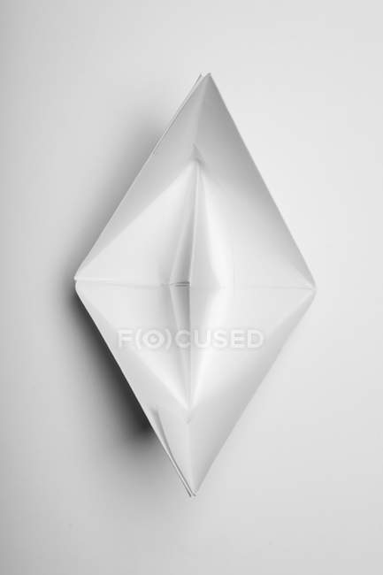Paper boat on white background, top view — Stock Photo