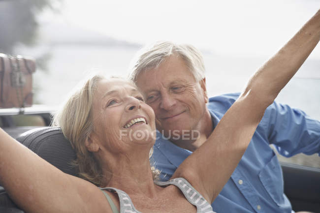 Senior couple sitting in car — Stock Photo