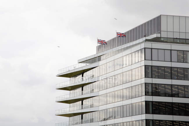 England, London, Modern architecture with british flags — Stock Photo