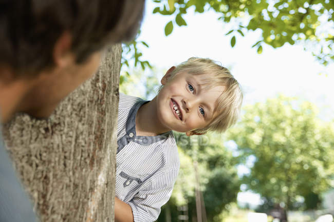 Smiling Father and son playing head and seek — Stock Photo