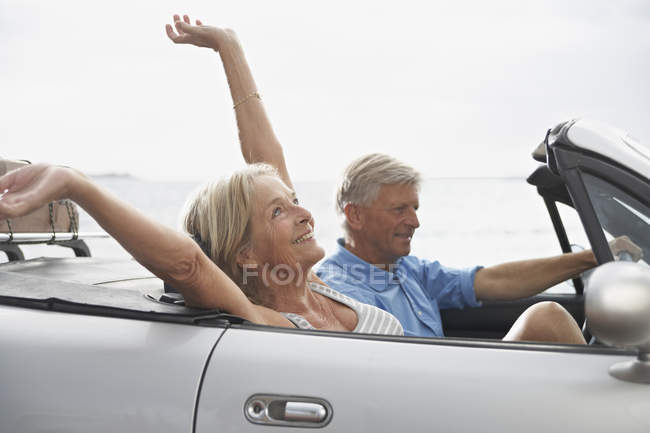 Couple driving in convertible car — Stock Photo