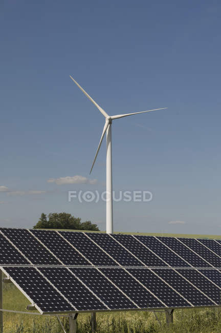 View of wind turbine with solar panels at daytime, Saxony, Germany — Stock Photo